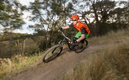 A mountain bike rider speeds through a corner on a track near Wodonga.