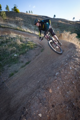 A mountain bike rider heads down a steep berm near Wodonga