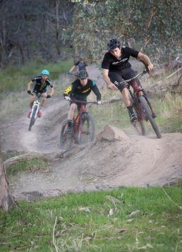 A group of 4 mountain bike riders negotiate the turns on a track near Wodonga