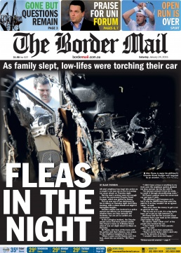 Front Page of The Border Mail newspaper Janruary 24, 2015. Photo looking into a burnt out car by John Russell