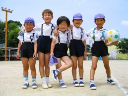 Five young Japanese boys pose for a portrain in school uniform
