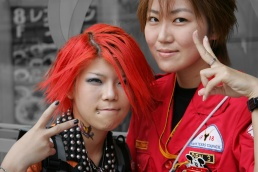 Two counter-culture Japanese girls give the victory sign