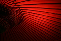 Abstract section of a red Japanese parasole fan