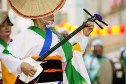 A Japanese lady playing a traditional instrument during the Awa Odori festival