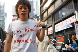 Japanese man wearing t-shirt saying I'm afraid of Americans