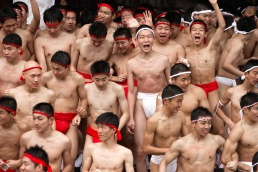 Japanese men wearing loin cloths participate in the Hadaka Matsuri festival on Osaka