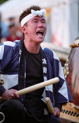 Japanese Taiko drummer with head scarf yelling