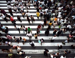 Ariel photo of people crossing a zebra crossing in Japan